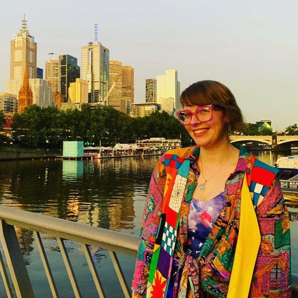 Alex in front of Melbourne skyline
